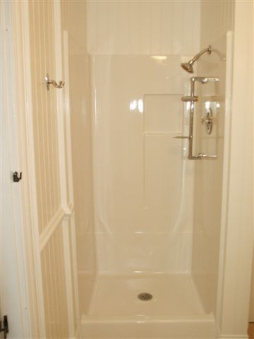 THIS IS A 3 PIECE SHOWER THE CUSTOMER WANTED THE SEAMS FILLED AND THE COLOR  CHANGED TO WHITE